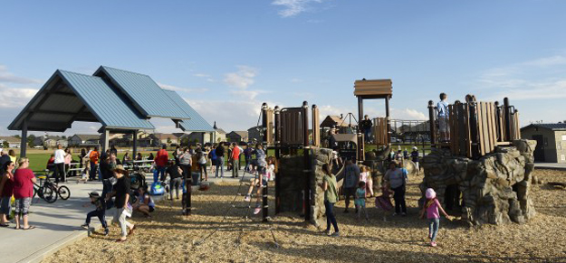 COMMERCE CITY, CO - SEPTEMBER 22: Families play at Villages East Park during a grand opening celebration on September 22, 2016, in Commerce City, Colorado. Villages East Park is the third park in a capital improvement program to open in Commerce City. (Photo by Anya Semenoff/The Denver Post)